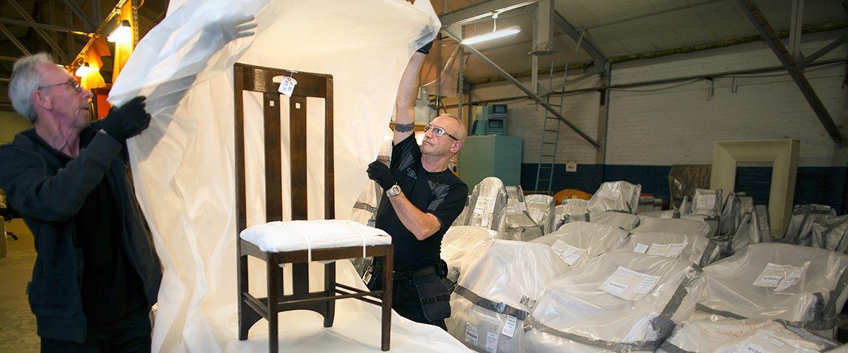 Technicians wrap a Mackintosh chair in preparation for the move to Kelvin Hall