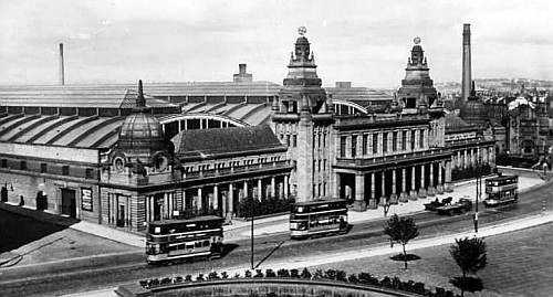 Old image of Kelvin Hall with trams running along Dumbarton Road